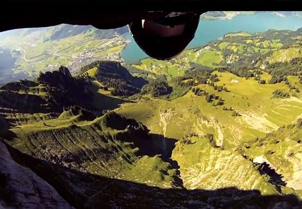 Wing-Suit Base Jumper Skims Feet Above The Ground