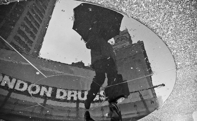 Reflections Off Wet Sidewalks Makes For Interesting Portraits