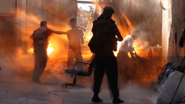 Photographer Catches Exact Moment Of A Tank Shell Hitting Syrian Rebels
