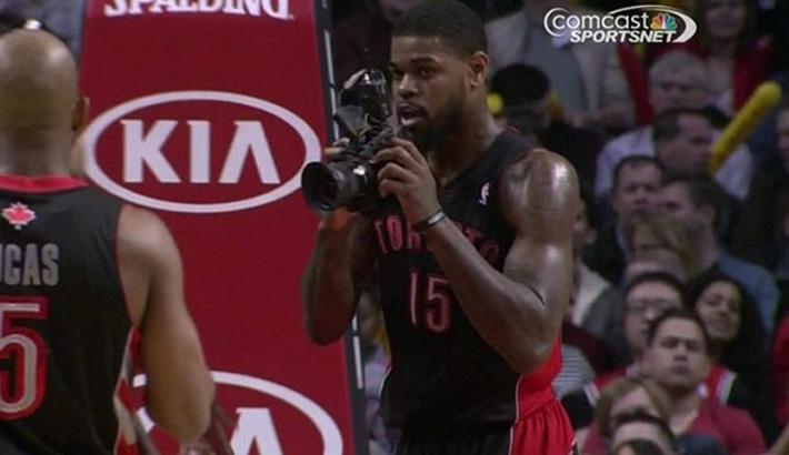 NBA Player Picks Up Photographer's DSLR and Snaps Away