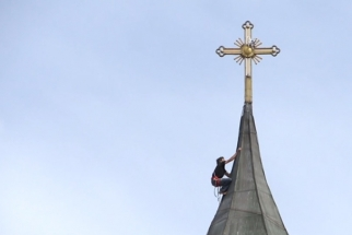 Rock Climber Scales Church To Retrieve Stuck Camera Drone
