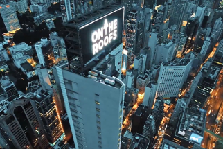 On Roof Tops Crew Hijack Sign in the Heart of Hong Kong