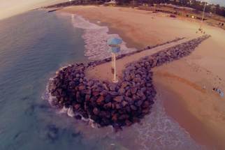Photographer Ryan Chatfield Sprints Beach, Climbs Rocks, to Save Drone from Waves Below