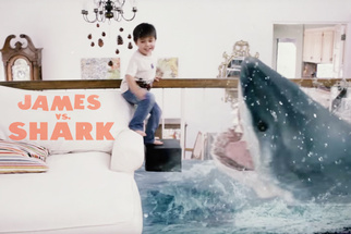 "Watch as 3-year-old ""Action Movie Kid"" Fends Off a Shark Attack in His Living Room"