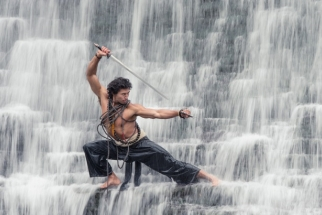 Asian Superhero in Waterfalls with 400mm