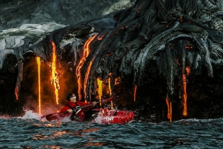 Thrill Seeking Kayakers & A Photographer Chase Hot Lava
