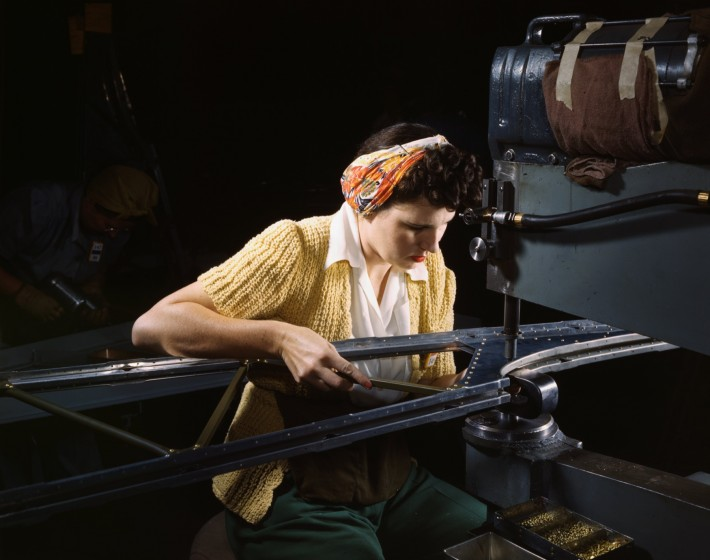 A_girl_riveting_machine_operator_at_the_Douglas_Aircraft_Company_plant_joins_sections_of_wing_ribs