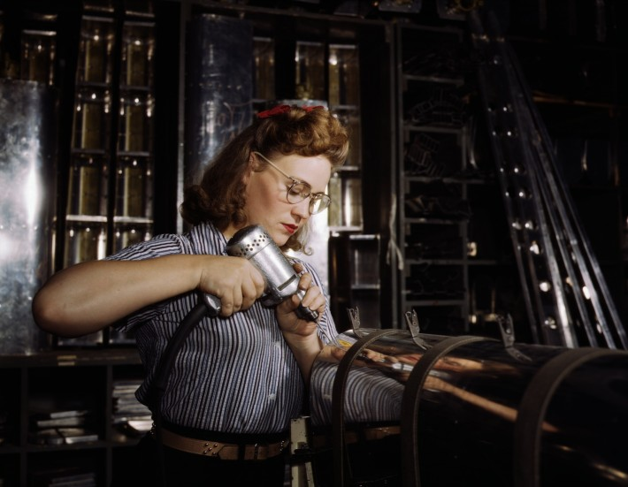 Operating_a_hand_drill_at_North_American_Aviation,_Inc,_a_woman_is_working_in_the_control_surface_department_assembling_a_section_of_the_leading_edge_for_the_horizontal_stabilizer_of_a_plane,_Inglewood,_Calif
