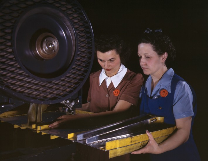 Punching_rivet_holes_in_a_frame_member_for_a_B-25_bomber,_the_plant_of_North_American_Aviation,_Inc,_Calif