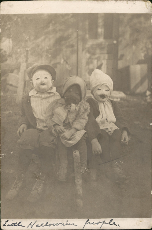 A vintage photo shows children in Halloween masks