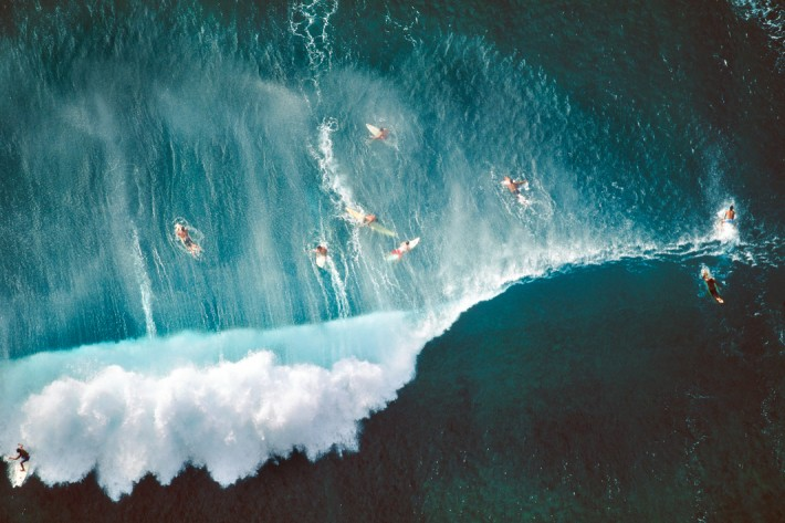 Surfers Behind Breaking Wave, Oahu, Hawaii, 1998 by Alex MacLean