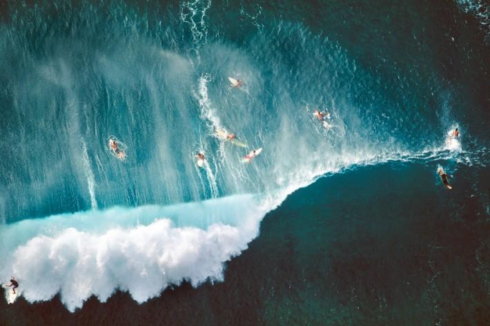 Surfers Behind Breaking Wave, Oahu, Hawaii, 1998 by Alex MacLean