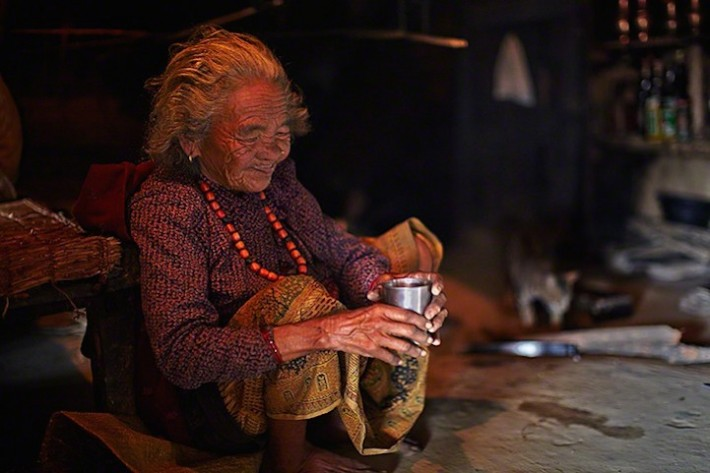 Nepalese villager preparing honey tea
