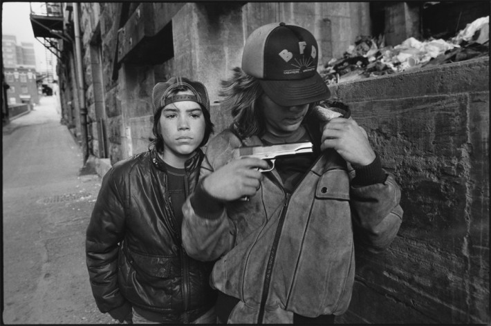 Image name: 'Rat' and Mike with a Gun, Seattle, Washington 1983 Streetwise Copyright: @Mary Ellen Mark