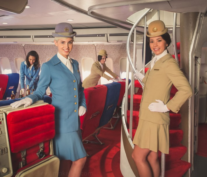 First class passengers are welcomed on board through a private jetway and led to their seats in the forward cabin.