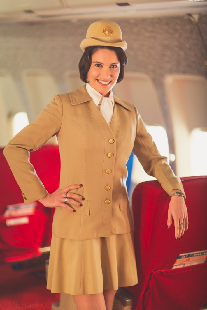 Before boarding, stewardesses prepare the forward cabin for arriving passengers. Magazines, headsets, blankets and pillows. There would typically be at least four flight attendants servicing the forward first class cabin.